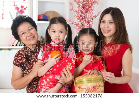 Beautiful multi generations Asian family celebrate Chinese new year at home. - stock photo