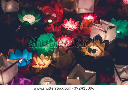 Beautiful Multicolored floating lanterns in the water in Chinese or Japanese style  - stock photo