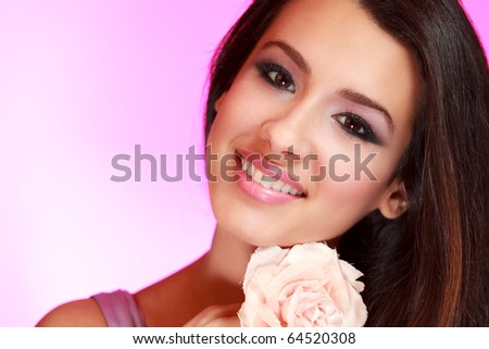 Beautiful multicultural young woman with a purple filtered background. - stock photo