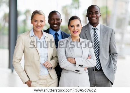 beautiful multiracial business team in office - stock photo