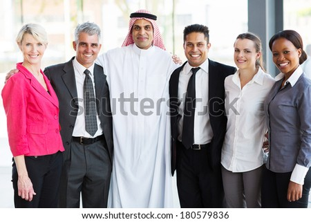 beautiful multiracial business team looking at the camera - stock photo