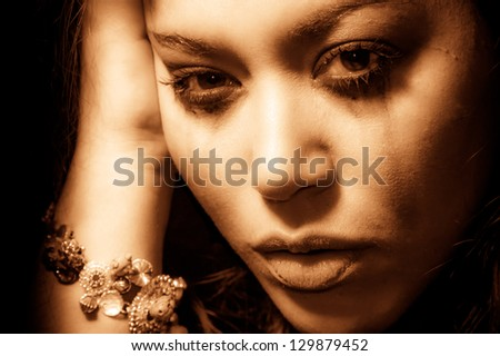 Beautiful multiracial girl in tears
