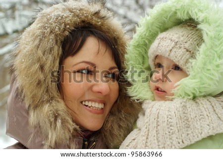 beautiful mum and daughter walking on the street