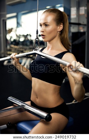 beautiful muscular fit woman exercising building muscles - stock photo