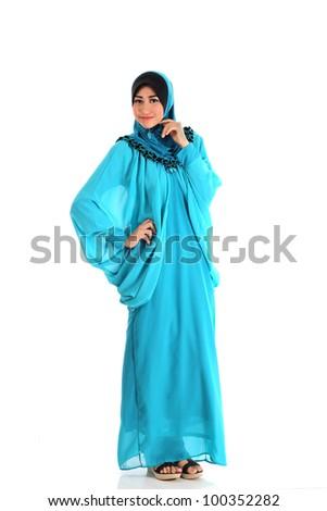 Beautiful Muslim fashion girl pose isolated on white - stock photo