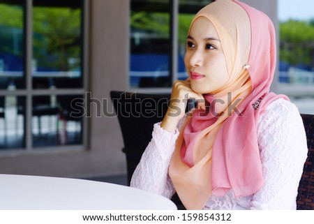 Beautiful Muslim girl at the cafe