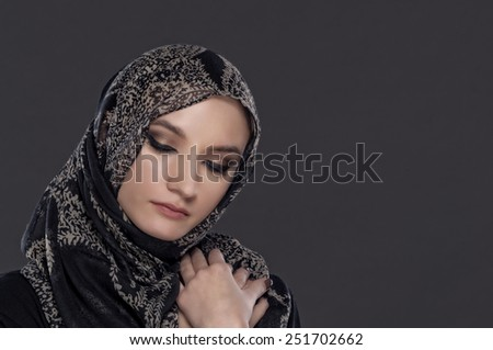 beautiful Muslim girl portrait on dark background - stock photo