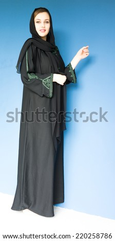Beautiful Muslim girl with a scarf - stock photo