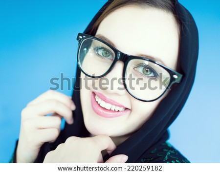 Beautiful Muslim girl with a scarf and glasses - stock photo
