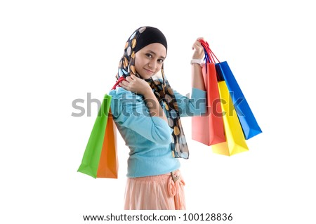 beautiful muslim girls with shopping bags - stock photo
