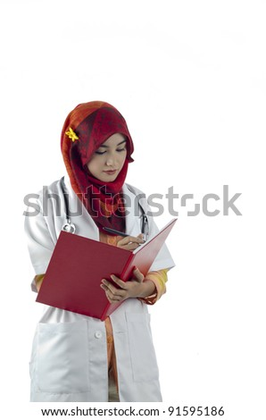 beautiful muslim medical doctor woman writing on note book isolated on white background - stock photo