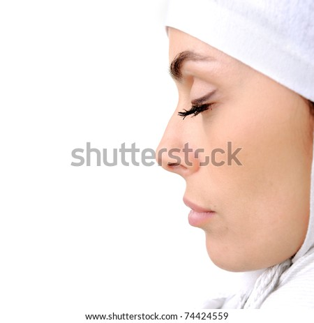 Beautiful Muslim woman isolated on white, profile - stock photo