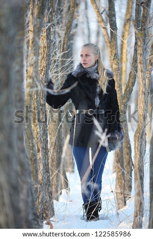 beautiful mysterious girl in a winter forest