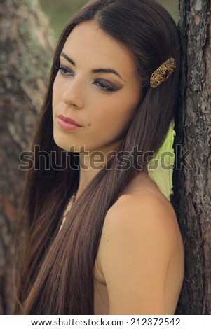 beautiful mysterious woman in forest