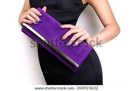 Beautiful nail art for elegant fashion with purple bag and black dress. Nice curvy body.  - stock photo