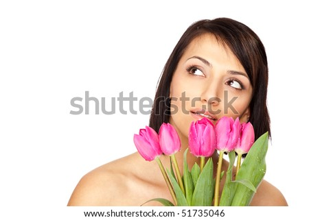 Beautiful naked shouders female holding a bunch of pink tulips isolated on white - stock photo