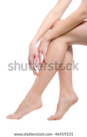 beautiful naked woman legs, isolated over white - stock photo