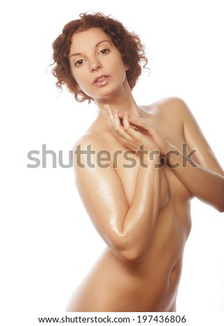 Beautiful naked woman poses covering itself hands, isolated on a white background