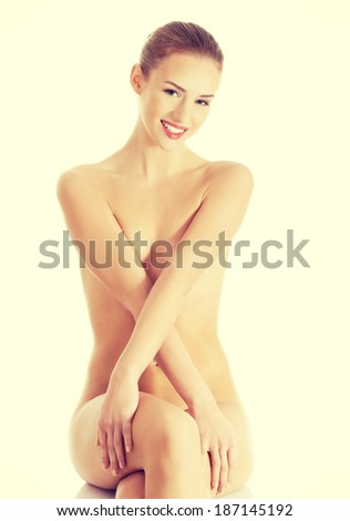 Beautiful naked woman sitting,having fresh clean skin.  Isolated on white.