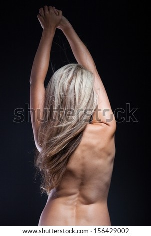 Beautiful naked woman with magnificent blond hair, back view - stock photo