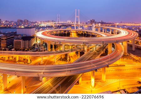 beautiful nanpu bridge at dusk ,crosses huangpu river ,shanghai ,China - stock photo