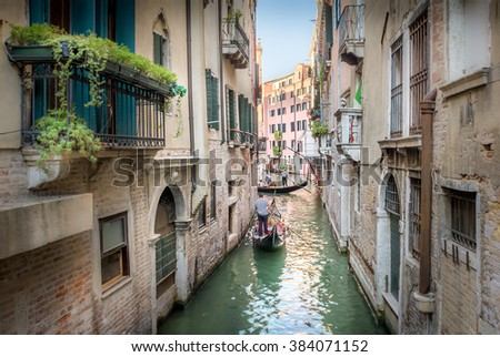 Beautiful narrow canal and gondolas in Venice, Italy