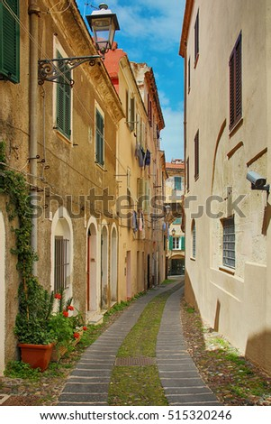 Beautiful narrow street in Alghero old town, Sardinia, Italy