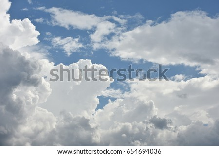 Beautiful natural fluffy cloudscape pattern with blue sky background
