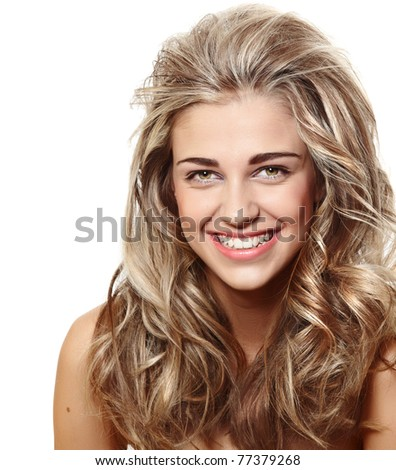 beautiful natural make-up woman with blond long hair in curly hairstyle smiling at camera isolated on white