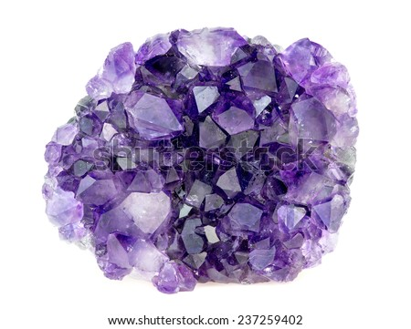 Beautiful natural purple amethyst geode crystals gemstone isolated on white - stock photo