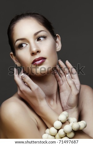 beautiful natural woman with false lashes and classic make-up with red lipstick - stock photo