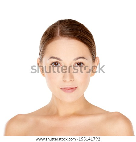 Beautiful natural young woman with a lovely smooth complexion and bare shoulders looking directly at the camera  isolated on white
