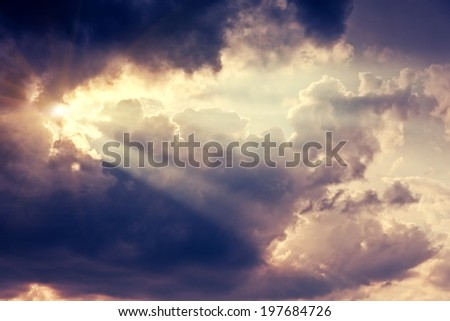 Beautiful nature background. Fantastic colorful sunset and dark ominous clouds. Beauty world. - stock photo
