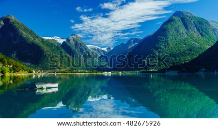Beautiful Nature Norway natural landscape with white boat.