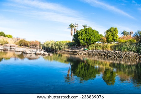 Beautiful nature of the coastline of the Nile river called First Cataract, Aswan, Egypt - stock photo