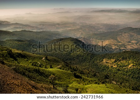 Beautiful nature scenic landscape of the hills and mist. - stock photo