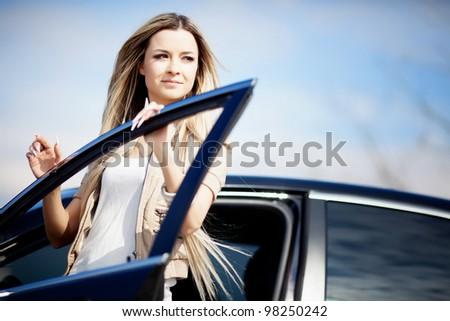 Beautiful near the car - stock photo
