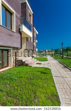 beautiful new apartment building, outdoor - stock photo