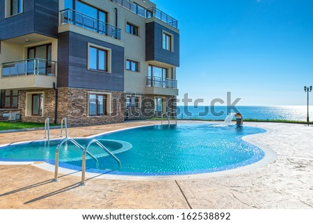beautiful new apartment building, outdoor, pool view  - stock photo