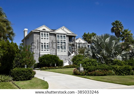 Beautiful New Florida House with Palms Trees and Landscaping - stock photo