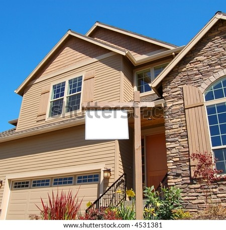 Beautiful new Home with Blank Sign - stock photo