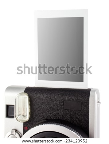 Beautiful new instant film camera isolated on white - stock photo