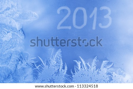 Beautiful New Year background (frozen window with 2013 written on it)