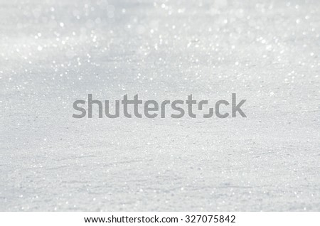 Beautiful New Year Christmas background of texture snow with bokeh. Trendy selective focus with shallow depth of field - stock photo