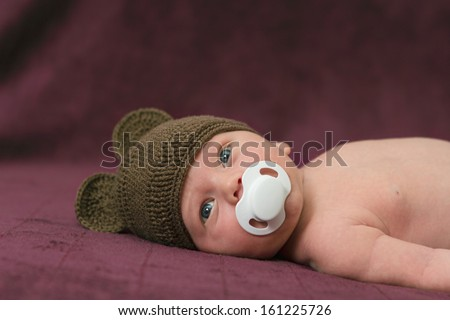Beautiful newborn baby closeup with soother - stock photo
