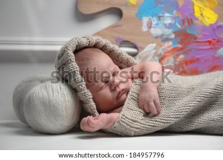 beautiful newborn boy on a beautiful background - stock photo