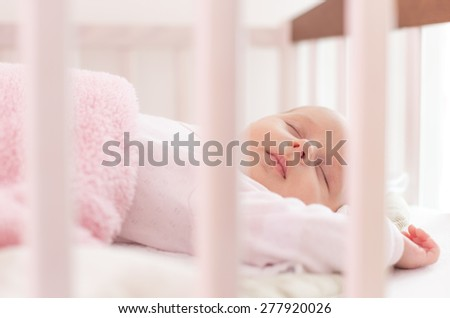 beautiful newborn sleep in crib - stock photo