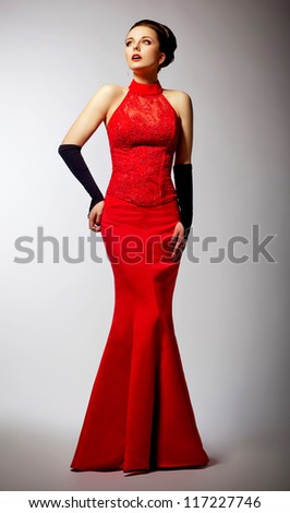 Beautiful newlywed in long wedding red dress - femininity and elegance - stock photo