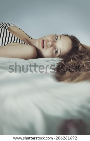 beautiful nice woman with long ringlets hairs - stock photo