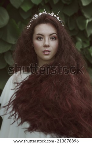 beautiful nice woman with long ringlets hairs - stock photo